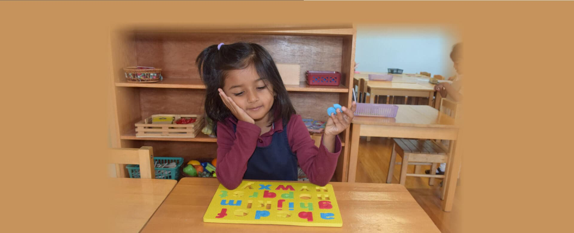 girl with alphabet puzzle