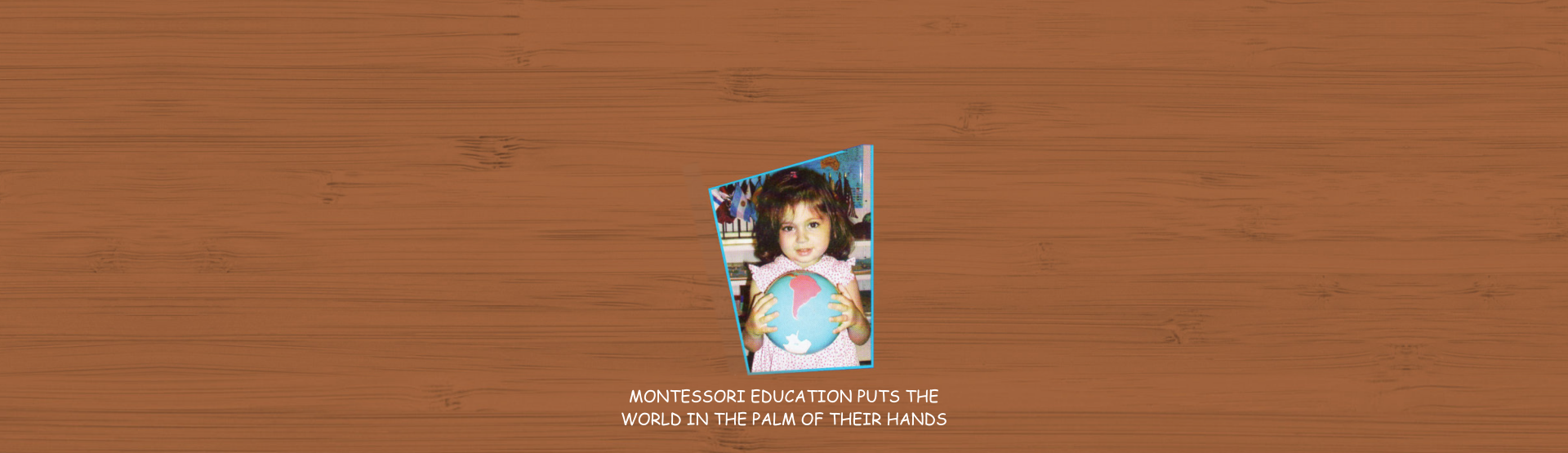 little girl standing holding a globe