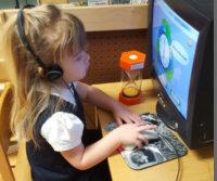 kid playing computer